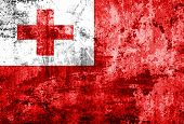 Tonga Flag on grunge paper