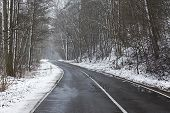 Snowy road in winter landscape