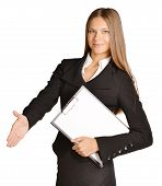 Business woman stretches out a hand of greeting. holds clipboard.