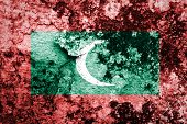 Maldives Flag painted on grunge wall.