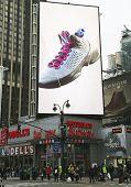 Jordan Flight Plate sneaker on billboard at Modell's 's sport goods store in Manhattan