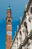 image of vicenza  - Bottom perspective of the famous Clock Tower of Vicenza with the Palladian Basilica and its typical statues - JPG