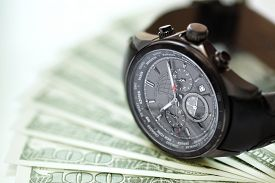 pic of time-saving  - Watch and money concept for business investment or time is money - JPG