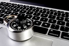 stock photo of ultralight  - A modern compact silver aluminum laptop with closeup of combination security lock to show strength - JPG