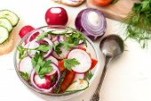 pic of chinese parsley  - Spring salad with radishes cucumber Chinese cabbage and red onion closeup on a white wooden background - JPG