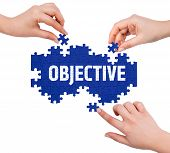stock photo of objectives  - Hands with puzzle making OBJECTIVE word isolated on white - JPG