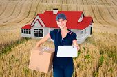 stock photo of household farm  - Happy delivery woman holding cardboard box and clipboard against rural fields - JPG