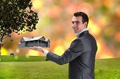 image of presenting  - Businessman presenting with hand against glowing lights behind field - JPG
