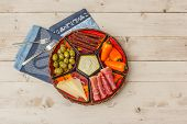 image of wooden basket  - Basket with Spanish tapas on a rustic white wooden table - JPG
