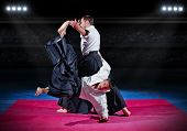 pic of aikido  - Fight between two aikido fighters at sport hall - JPG
