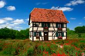 foto of alsatian  - A small Alsatian house serves as a visitor center for the Little Alsace of Texas - JPG