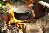 image of kettles  - Pot water on the fire tourists kettle on hot campfire - JPG