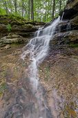picture of dam  - A beautiful little waterfall cascades over layers of rock strata near the dam at Indiana - JPG