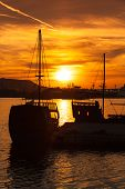 foto of brigantine  - Recreation sailing ships stand moored in Varna port at the sunset - JPG