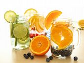 pic of masonic  - Detox water with various types of fresh fruit in mason jar glasses on a table - JPG