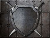 foto of crossed swords  - knight shield and two swords over armor plates  - JPG
