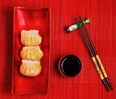 pic of siomai  - steamed shrimp dumplings served on a traditional bamboo place mat - JPG