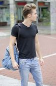 image of bagpack  - Attractive young man wearing black T - JPG