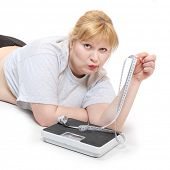 foto of anorexic  - Depressed woman with measure tape and weight scale - JPG