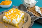 foto of jello  - Hawaiian salad made with lemon jello pineapple banana mini marshmallows topped with whipped cream and cheddar cheese - JPG