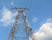 picture of power transmission lines  - Electric power lines and pylon against blue sky - JPG