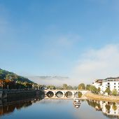 picture of french culture  - Morning Mist in the French City of Terrasson - JPG