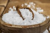 stock photo of salt-bowl  - Sea salt in bowl and spoon on a wooden background - JPG
