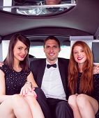 stock photo of limousine  - Pretty girls with ladies man in the limousine on a night out - JPG
