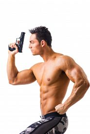 image of handgun  - Half body Shot of a Handsome Athletic Man with no Shirt Holding a Handgun While Looking to the Left of the Frame - JPG