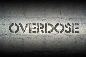 image of overdose  - overdose stencil print on the grunge white brick wall - JPG
