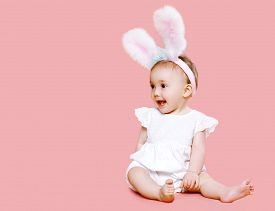picture of bunny costume  - Sweet pink cute baby in costume easter bunny with fluffy ears - JPG
