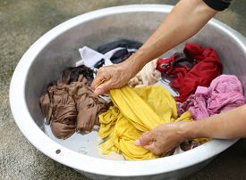 image of matron  - Hands wash stain of dirty clothes in big bowl  - JPG