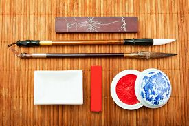 stock photo of chinese calligraphy  - the Chinese set for calligraphy the art of calligraphy brush for Chinese painting bamboo brush Chinese ink goods for calligraphy - JPG