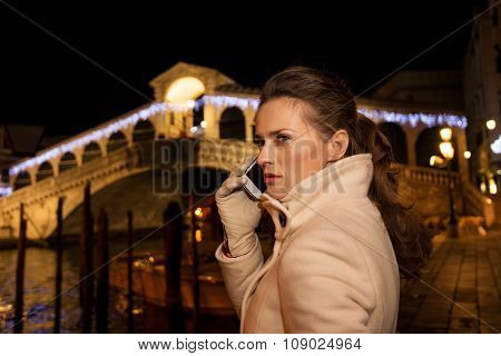 Woman Talking Cellphone While Spending