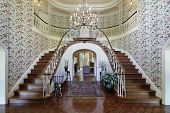 stock photo of entryway  - Large foyer in luxury home with double staircase - JPG