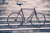 Road bicycle fixed gear bike on city concrete street. Urban industrial cycling bike on city stairs poster