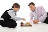 Dad and son playing chess