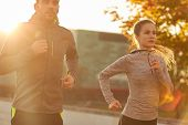 fitness, sport, people and lifestyle concept - couple running outdoors poster
