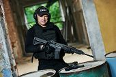 Постер, плакат: Military industry Special forces or anti terrorist police soldier portrait private contractor arm
