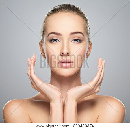 poster of Beautiful face of young caucasian woman with perfect health clean skin.  Skin care treatment. Portra