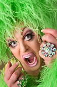 image of drag-queen  - Scared drag queen wearing heavy makeup and boa hat - JPG