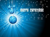 abstract blue rays background with hanging decorated xmas ball