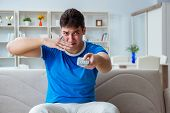 Man sweating excessively smelling bad at home poster