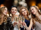 holidays, celebration and people concept - happy women clinking non alcoholic champagne glasses at n poster