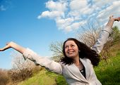 The Happy Attractive Woman With The Lifted Hands