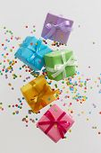 Colorful gift boxes with confetti falling or flying in motion. poster