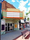 stock photo of movie theater  - Old Movie theater in a small downtown area - JPG