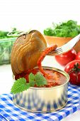 picture of musky  - a tin of musk octopus in tomato sauce - JPG