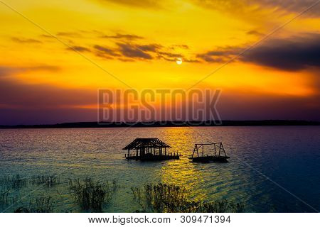 poster of Sunset On The River. Nature River In Sunset. Beautiful Sunset In The Nature In Autumn. Autumn Sunset