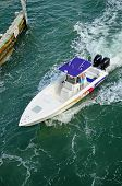 pic of outboard engine  - small sport fishing boat powered by two outboard engines - JPG